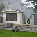 Houten vakantiehuis in brand bij de Veerdam te Kortgene