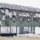 Middelbrand in leegstaande loods te 's-Heerenhoek